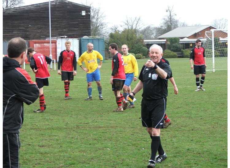 Referee Mick White makes his point
