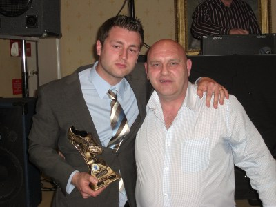 Nic Turpin receives the Manager's Player of the Year award from Glen Butterfield