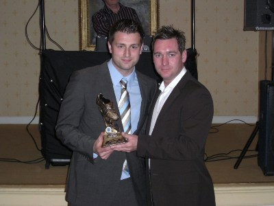 Nic Turpin receives the Player's Player of the Year award from Jason Cameron