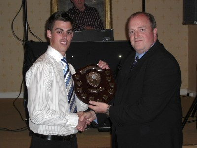 Ben Pryce receives the Sponsor's Player of the Year award from Spencer Mulholland