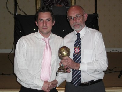 Lee Bartlett receives the Supporter's Player of the Year award from Graham Ashman