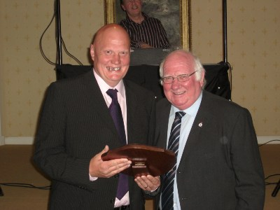 Ian Jones receives the Clubman of the Year Shield from club president Sammy Dunford