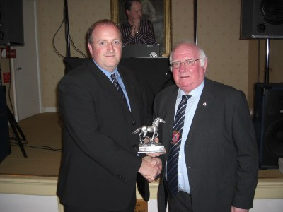 Spencer Mulholland (Independent Bookmakers) receives a special appreciation award from Club President Sammy Dunford