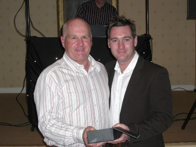 Richard Bawden receives an appreciation award from Jason Cameron