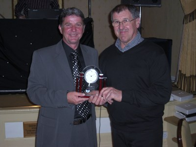 Pete Taylor receives a special award from Micky Saunders to mark his record 491 appearances for the club