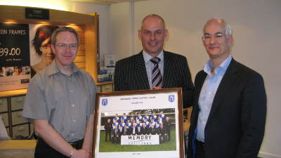 Presentation of framed photo to Sponsors Memory Opticians from Craig Bruce, Commercial Manager, Amesbury Town FC - Nov 14 2007