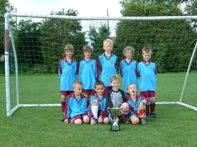 Some of the team proudly showing off the Beauliea FC Tournament Cup which was won in the 2006-07 season
