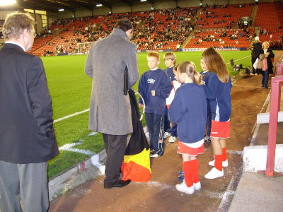 The kids receive their orders from the man from the FA all the way from London.