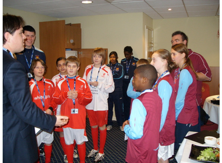 The kids are briefed by West Ham officials