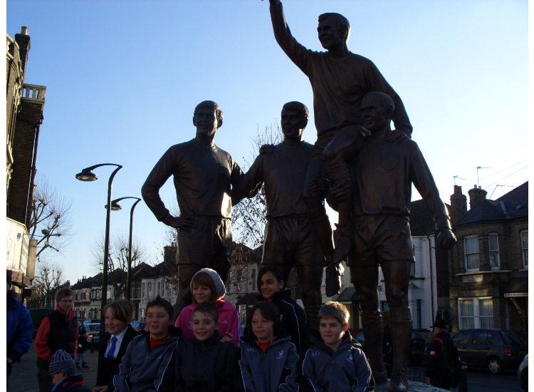 Posing outside the Bobby Moore memorial