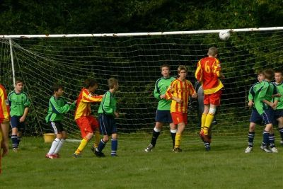 The U14 B Teams Carl Gallagher leaps to head a corner