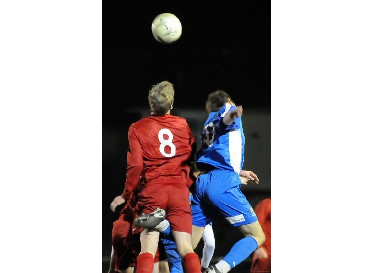 In the replayed game, Ollie PHILLIPSON-MASTERS wins this header at the heart of the Poppies defence.