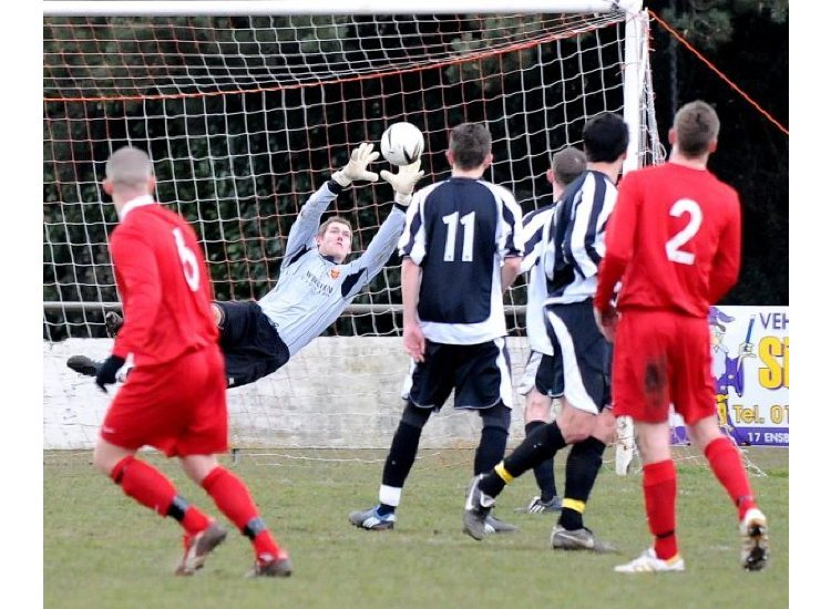 Hayling's Tony HARROP pulls off a great save to deny the Poppies
