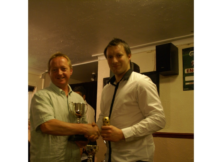 Tom Buckler receiving the 1st Team Managers & Supporters Player of the Year from Sponsor ARG