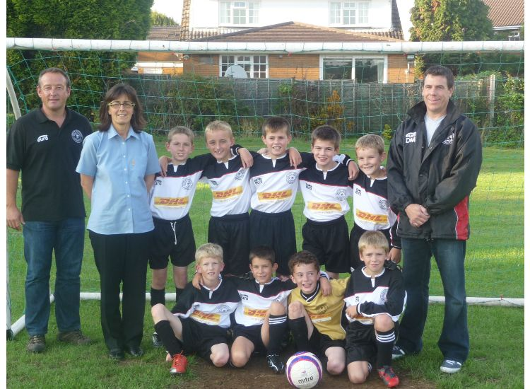 2010/11 Squad Proudly Showing Off Their New Shirts Kindly Sponsored by DHL Supply Chain