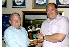 Chairman Emlyn Phillips presents Clubman of the Year to Mark Evans.