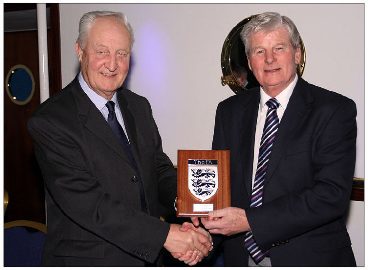 Gordon Howard (left) receiving FA plaque from David Richardson