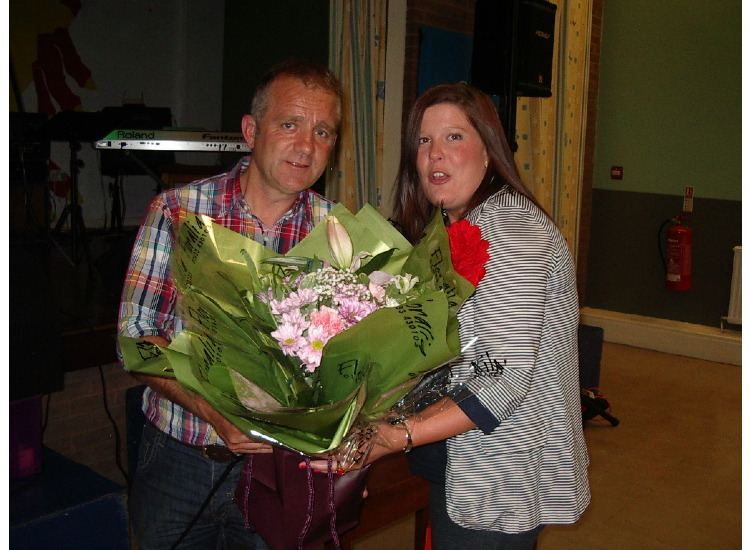 Laura receives flowers for her mum