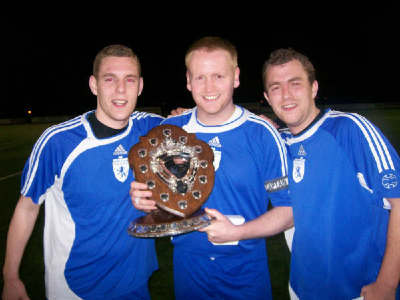 Man of the match Richard Woodward, Captain Mike Duckworth and Vis Captain Andy Wood with the winning Halawell Shield