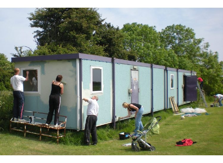 The portacabins emulate the Tories - from blue to green