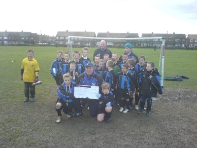 Our chairman,John Munns,Lee and Rob,with there teams with a cheque for the Ellie May Challis charity.The money was raised at our recent Christmas Party Auction.