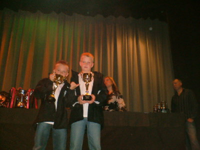 Callam and Jordan proudly show off their players player of the year trophies.