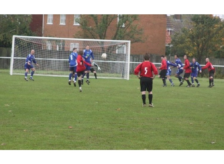 Keith Argent launches a free kick