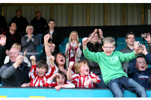 Supporters celebrate after the full time whistle