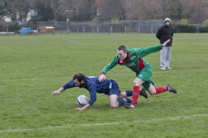Leading scorer Scott Bouvier in a tussle with Sam Marsh