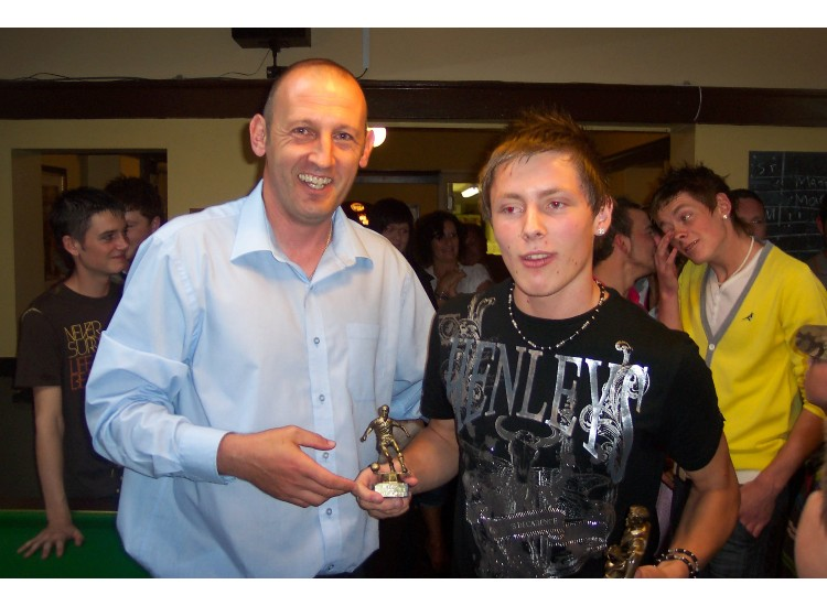 Luke Horwood receives his award for ' 100 Appearances '