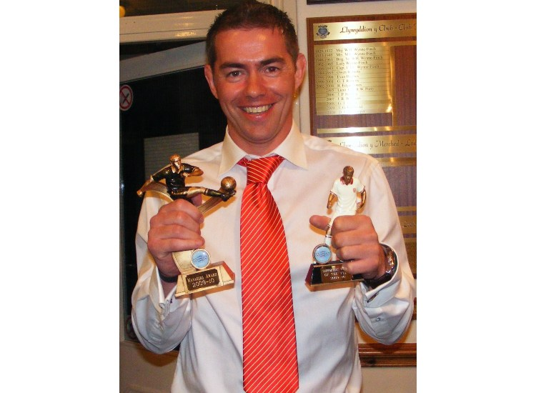 GWION ALL SMILES WITH HIS AWARDS
