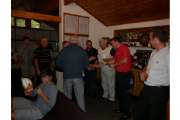 Neil, Gordon, Ian and Ray collecting their prizess from Stowe GC captain Simon Roberts