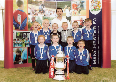 UNDER 9S PUMAS WITH THE F.A.CUP AT THE SALFORD MINI SOCCER TOURNAMENT