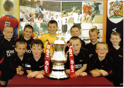 SOME OF THIS SEASONS SQUAD WITH THE F.A.CUP AT THE SALFORD MINI SOCCER FESTIVAL