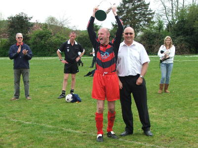 Dave Jeanes presented a delighted Sparky with the Premier Division Trophy