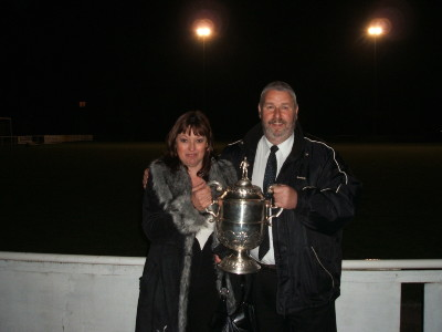 Steve and Margaret Coxon hold the Durham FA Trophy, won at Dunston Federation FC in April 2007.