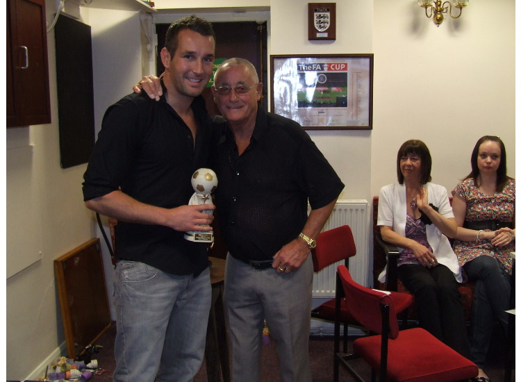 John Atkinson presents Steven Walklate with the Players Player of the Year award.