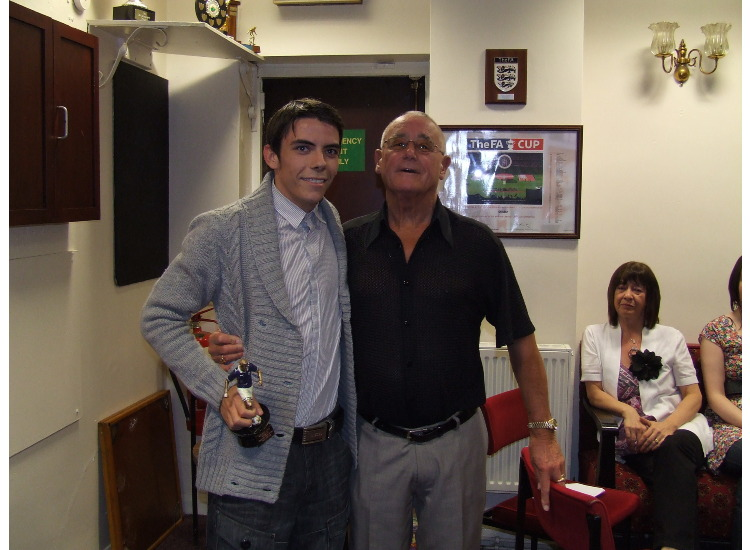 Sam Garvie receives the Supporters Player of the Year trophy from John Atkinson.