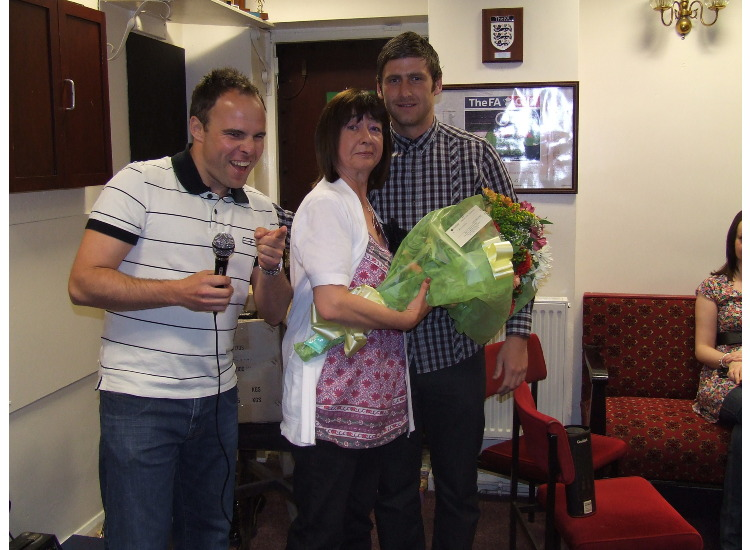 Christine Tray was given a bouquet as a token of appreciation for taking care of players' kits throughout the season.