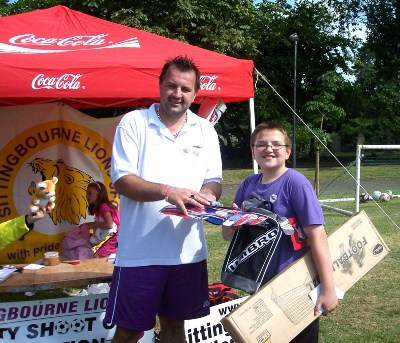 The penalty shoot prize draw winner, receiving his prizes from events Manager, Gavin Shearing.