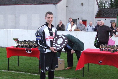 Captain Emmett Finnegan lifting the SBYL Under 17 Premier Division League trophy. Plunkett also won SBYL Cup to complete the domestic double.