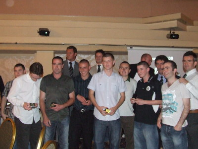 Some of the 1st team squad after receiving their League Winners medals from Phil Mulryne and Jim Magilton.