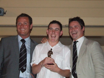 Under 18 Player of the Year Jody Lynch accepting his award from his Uncle Phil and Jim Magilton.