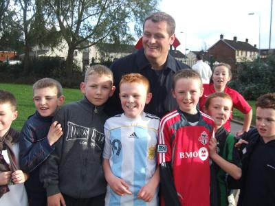 Plunkett legend Jim Magilton surrounded by mini soccer participants.