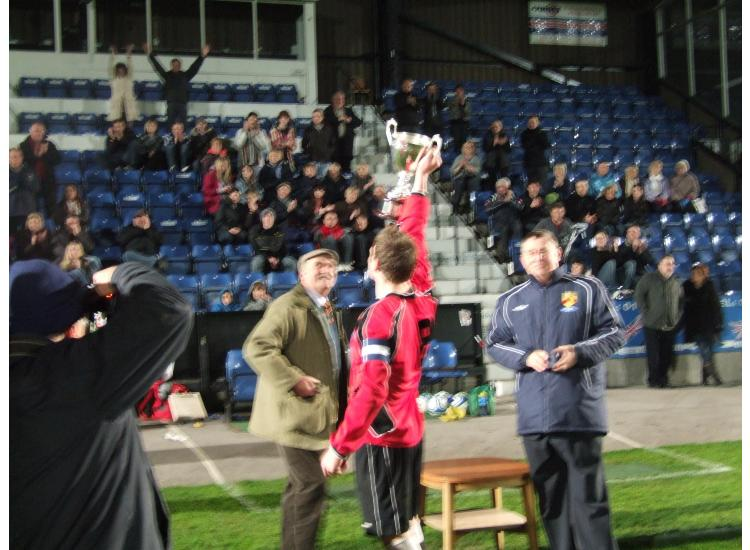 Niall holds the cup aloft