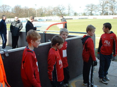 GEORGE,DANIEL AND SOME OF THE UNDER10s WAITING FOR THE PLAYERS TO MAKE AN APPEARANCE TO ENTER THE PITCH.