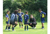 Paul gives his words of wisdom to his team which won the U10 - U12 age group