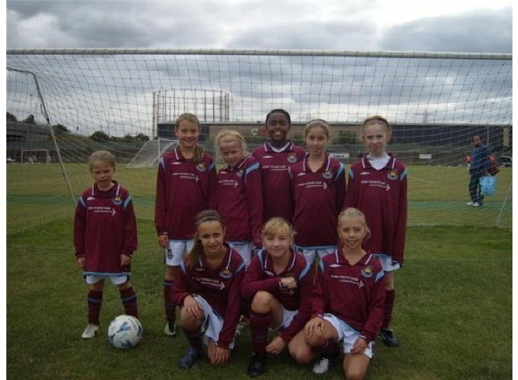 The squad line up before  the Tottenham Hotspur Festival