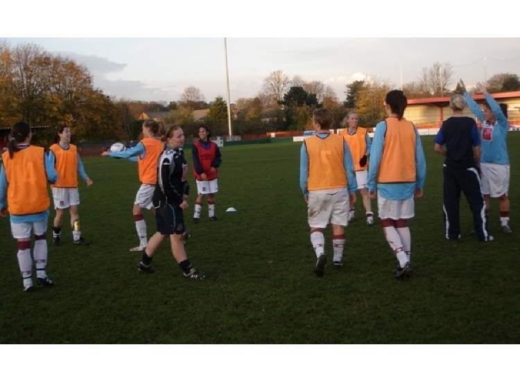 The squad warm up at Hemel Hempsted Town.