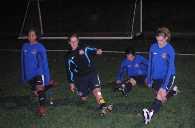 The squad stretching prior to training at Chadwell Heath